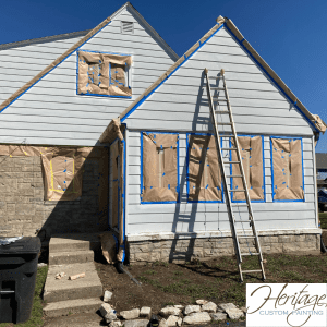 Protecting Windows, Doors and Gutters on a House Prior to Painting