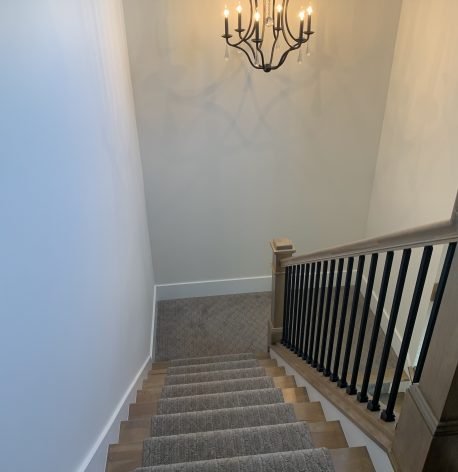 Tall Stairwell with White Satin walls, White Semi-Gloss Baseboards, and White Semi-Gloss Risers.