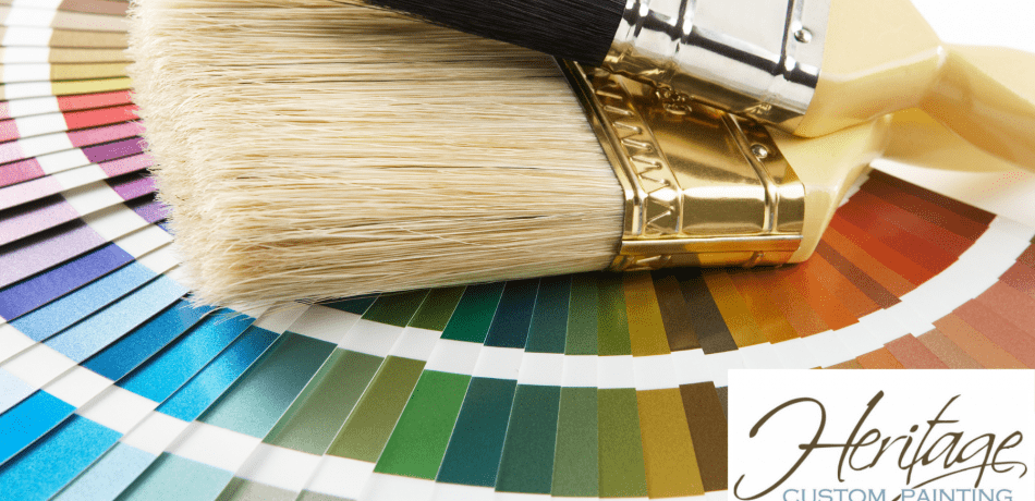 Two Paint brushes and a color chart against a white backdrop.